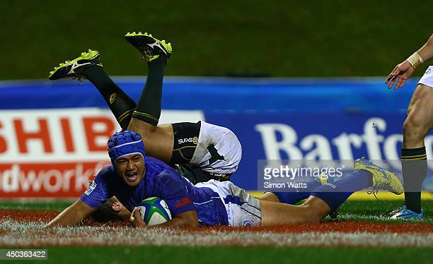 Nathaniel Apa of Samoa scores a try during the 2014 Junior World Championship match between Samoa and South Africa at ECOLight Stadium Pukekohe on...