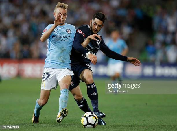 Nathaniel Atkinson of Melbourne City and Christian Theoharous of the Victory contest the ball during the round 12 ALeague match between Melbourne...
