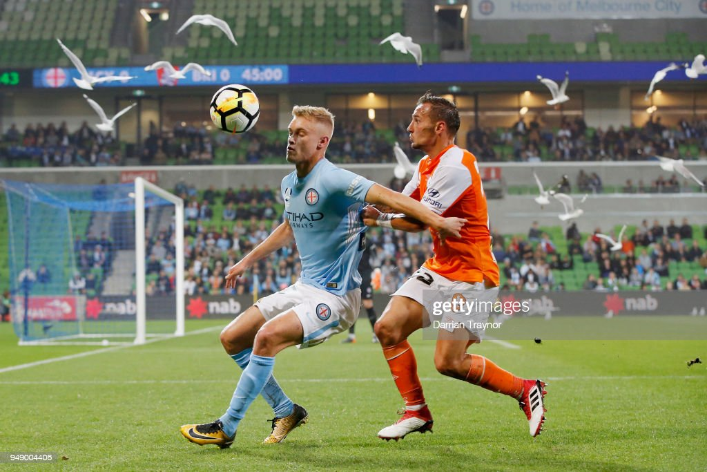 Nathaniel Atkinson of Melbourne City and Eric Bautheac of the Roar compete during the A-League Elimination Final match between the Melbourne City and the Brisbane Roar at AAMI Park on April 20, 2018 in Melbourne, Australia.