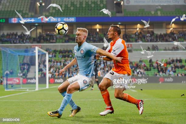 Nathaniel Atkinson of Melbourne City and Eric Bautheac of the Roar compete during the ALeague Elimination Final match between the Melbourne City and...