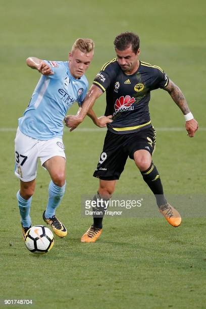 Nathaniel Atkinson of Melbourne City and Tom Doyle of Wellington Phoenix compete during the round 14 ALeague match between Melbourne City and the...