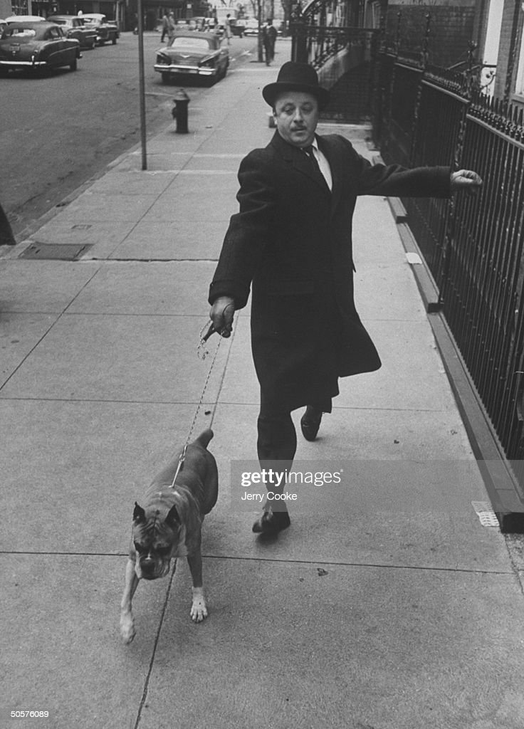 Nathaniel Benchley walking his dog.