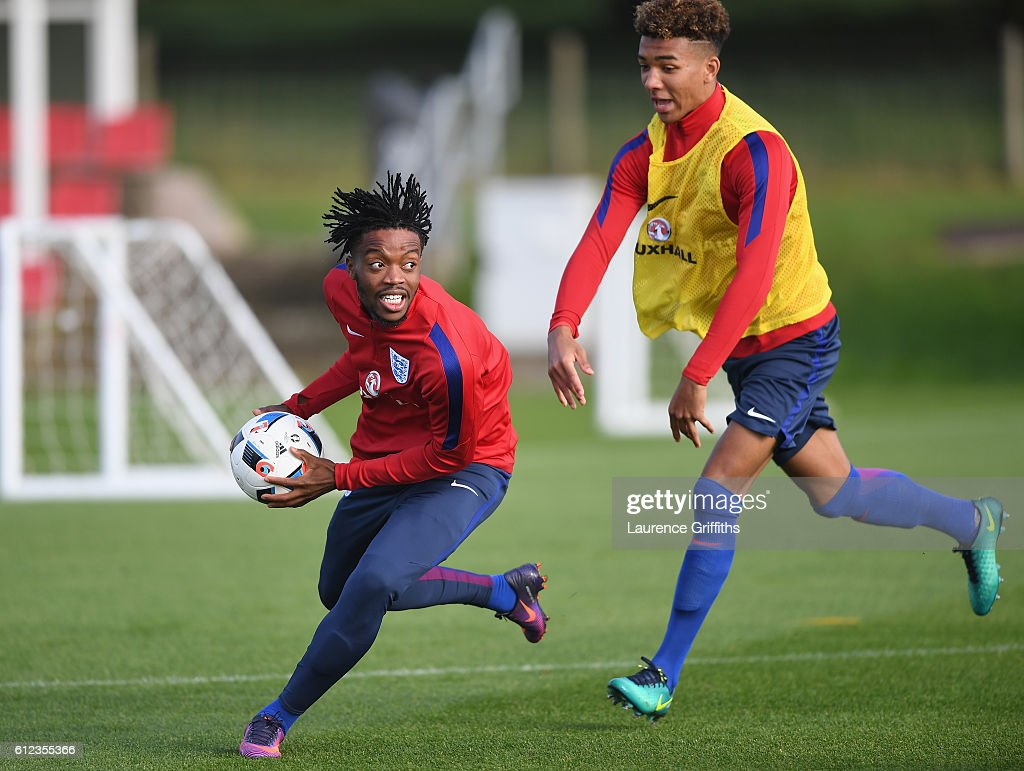 Nathaniel Chalobah and Nathan Holgate of England U-21 are all smiles during a training session at St Georges Park on October 4, 2016 in Burton-upon-Trent, England.