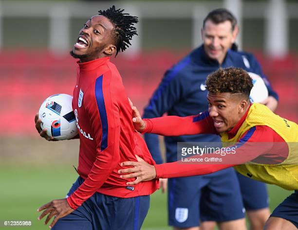Nathaniel Chalobah and Nathan Holgate of England U21 are all smiles during a training session at St Georges Park on October 4 2016 in BurtonuponTrent...
