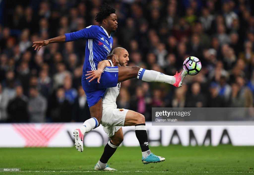 Nathaniel Chalobah of Chelsea and Nordin Amrabat of Watford battle for possession during the Premier League match between Chelsea and Watford at Stamford Bridge on May 15, 2017 in London, England.