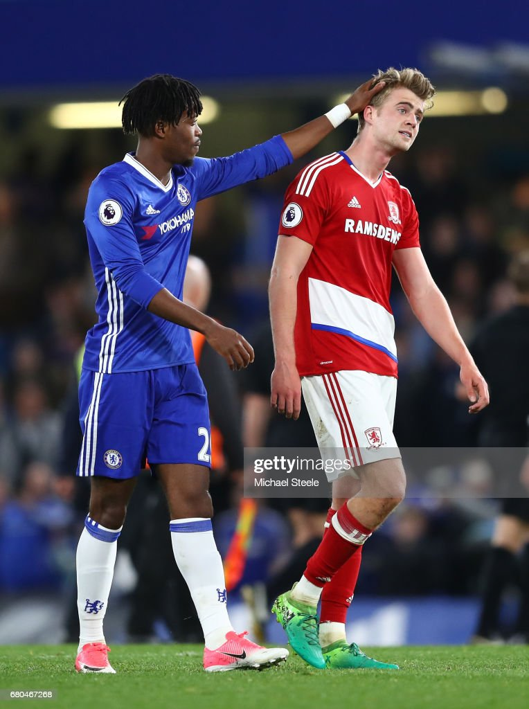 Nathaniel Chalobah of Chelsea consols Patrick Bamford of Middlesbrough after the game during the Premier League match between Chelsea and Middlesbrough at Stamford Bridge on May 8, 2017 in London, England.