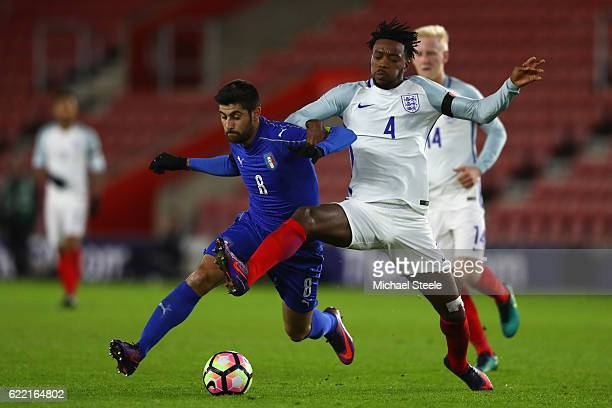 Nathaniel Chalobah of England challenges Marco Benassi of Italy closes in during the FIFA 2018 World Cup Qualifier between England and Italy at St...