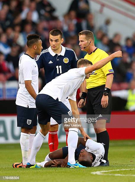 Nathaniel Chalobah of England U21 lies injured during the Kick It Out International between England U21 and Scotland U21 at Bramall Lane on August 13...