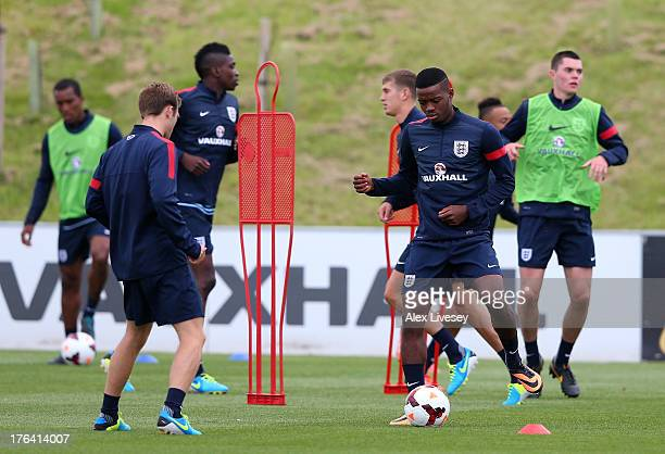 Nathaniel Chalobah of England U21's passes the ball during a training session at St Georges Park on August 12 2013 in BurtonuponTrent England
