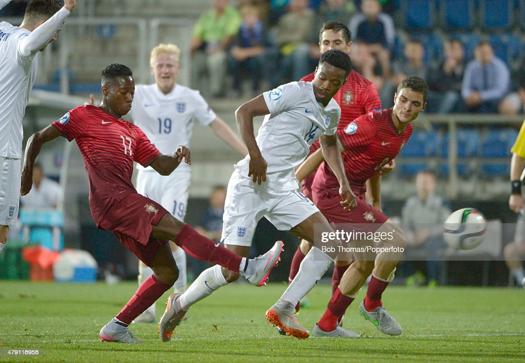 Nathaniel Chalobah of England with Carlos Mane (left) of Portugal during the UEFA Under21 European Championship 2015 Group B match between England and Portugal at Mestsky Fotbalovy Stadium on June 18, 2015 in Uherske Hradiste, Czech Republic. Portugal won the match 1-0. (Photo by Bob Thomas/Popperfoto/Getty Images).