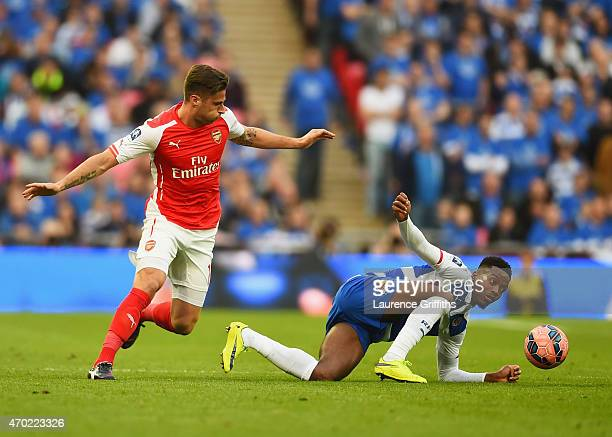 Nathaniel Chalobah of Reading battles with Olivier Giroud of Arsenal during the FA Cup Semi Final between Arsenal and Reading at Wembley Stadium on...