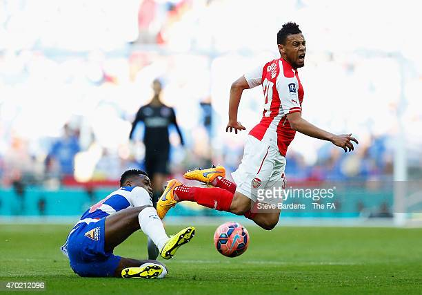 Nathaniel Chalobah of Reading challenges Francis Coquelin of Arsenal during the FA Cup Semi-Final match between Arsenal and Reading at Wembley...