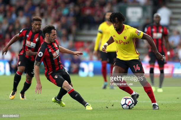 Nathaniel Chalobah of Watford attempts to get past Adam Smith of AFC Bournemouth during the Premier League match between AFC Bournemouth and Watford...