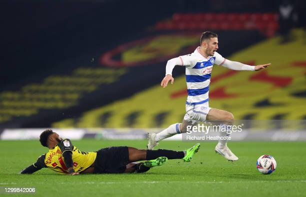 Nathaniel Chalobah of Watford FC challenges Dominic Ball of Queens Park Rangers during the Sky Bet Championship match between Watford and Queens Park...