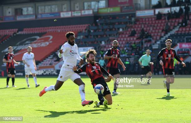 Nathaniel Chalobah of Watford is challenged by Ben Pearson of AFC Bournemouth during the Sky Bet Championship match between AFC Bournemouth and...