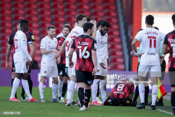 Nathaniel Chalobah of Watford stands over Jefferson Lerma of Bournemouth after he fouls him during the Sky Bet Championship match between AFC...