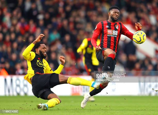 Nathaniel Chalobah of Watford tackles Jefferson Lerma of AFC Bournemouth during the Premier League match between AFC Bournemouth and Watford FC at...