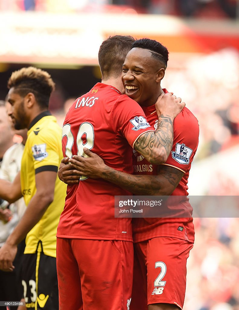 Nathaniel Clyne and Danny Ings of Liverpool celebrate at the end of the Barclays Premier League match between Liverpool and Aston Villa on September 26, 2015 in Liverpool, United Kingdom.