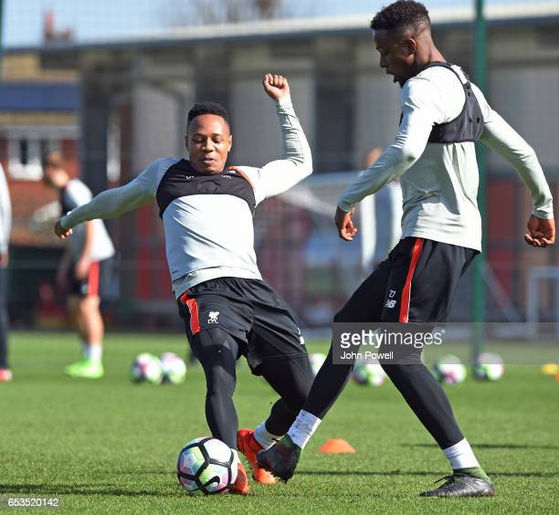 Nathaniel Clyne and Divock Origi of Liverpool during a training session at Melwood Training Ground on March 15 2017 in Liverpool England