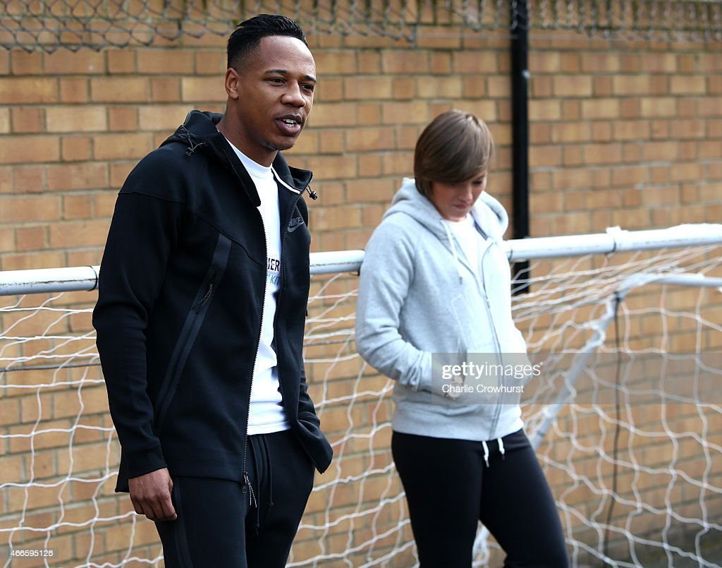 Nathaniel Clyne and Fran Kirby hold a Q & A with the children during the Premier League Players Kit Scheme Launch at Allen Edward Primary School on March 17, 2015 in London, England.
