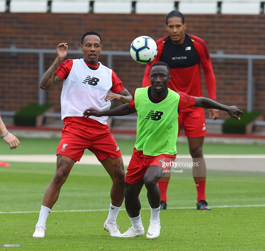 Nathaniel Clyne and Naby Keita during a training session at Melwood Training Ground on July 12, 2018 in Liverpool, England.