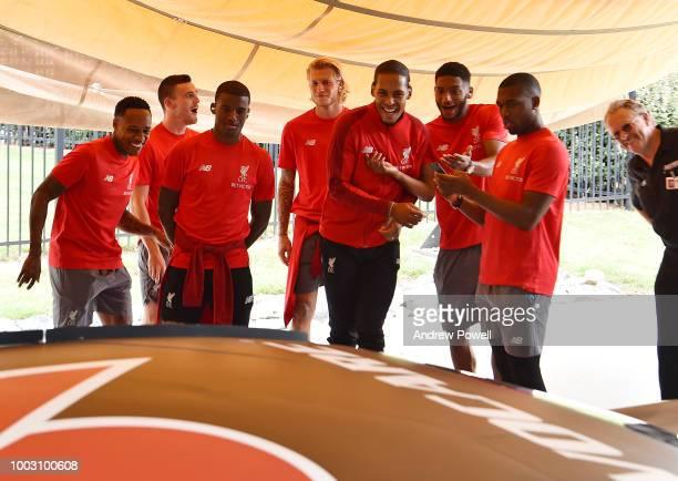 Nathaniel Clyne Georginio Wijnaldum Virgil van Dijk Joe Gomez and Daniel Sturridge of Liverpool laughing as players change tyres during a tour of...