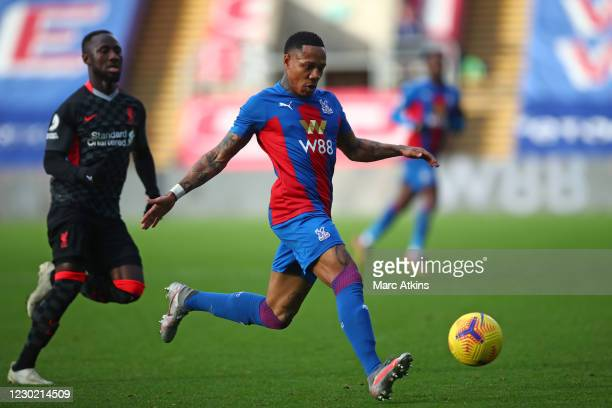 Nathaniel Clyne of Crystal Palace in action with Naby Keita of Liverpool during the Premier League match between Crystal Palace and Liverpool at...