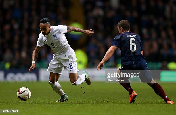 Nathaniel Clyne of England goes past Shaun Maloney of Scotland during the International Friendly match between Scotland and England at Celtic Park...