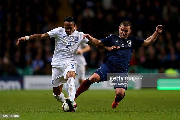 Nathaniel Clyne of England is tackled by Shaun Maloney of Scotland during the International Friendly match between Scotland and England at Celtic...
