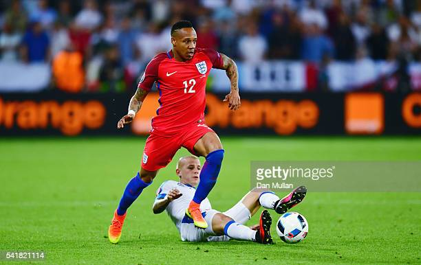 Nathaniel Clyne of England is tackled by Vladimir Weiss of Slovakia during the UEFA EURO 2016 Group B match between Slovakia and England at Stade...