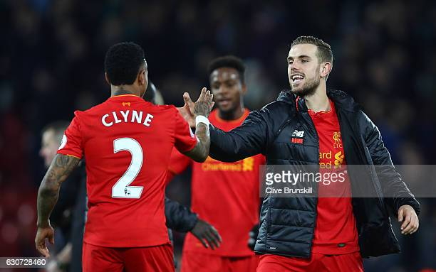 Nathaniel Clyne of Liverpool and Jordan Henderson of Liverpool celebrate victory during the Premier League match between Liverpool and Manchester...