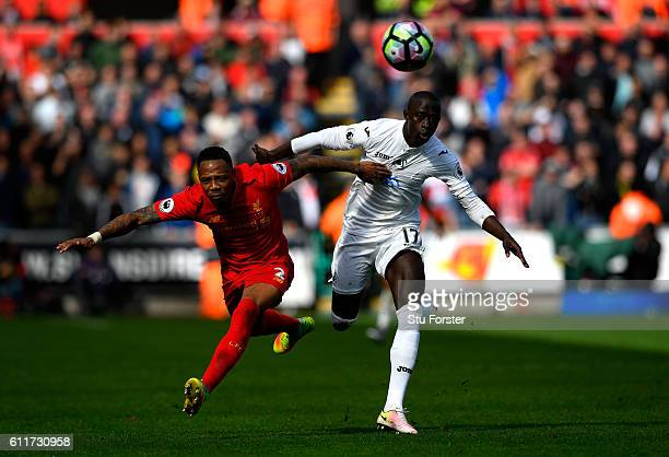 Nathaniel Clyne of Liverpool and Modou Barrow of Swansea City battle for possession during the Premier League match between Swansea City and...
