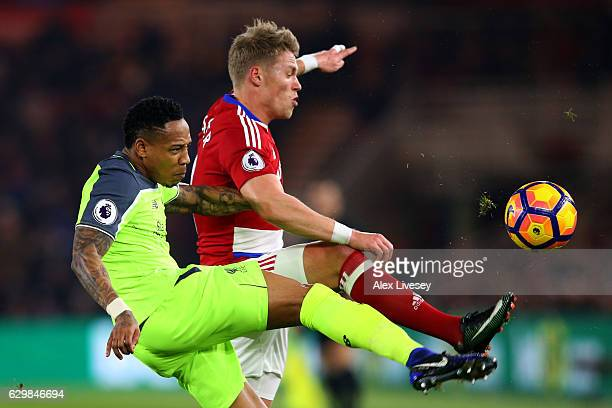 Nathaniel Clyne of Liverpool and Viktor Fischer of Middlesbrough battle for possession during the Premier League match between Middlesbrough and...