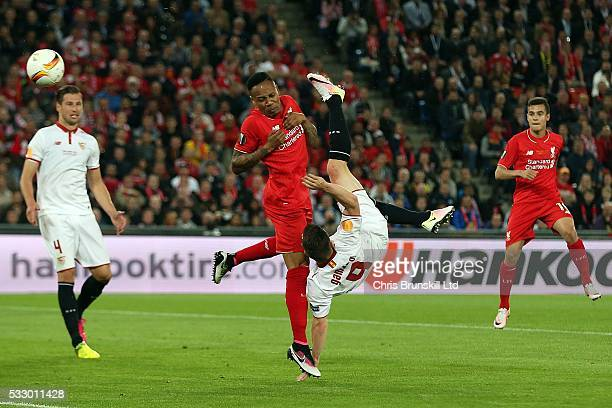 Nathaniel Clyne of Liverpool attempts to block an overhead kick from Kevin Gameiro of Sevilla during the UEFA Europa League Final match between...