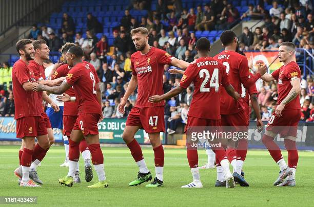 Nathaniel Clyne of Liverpool celebrates after scoring the opening goal during the PreSeason Friendly match between Tranmere and Liverpool at Prenton...