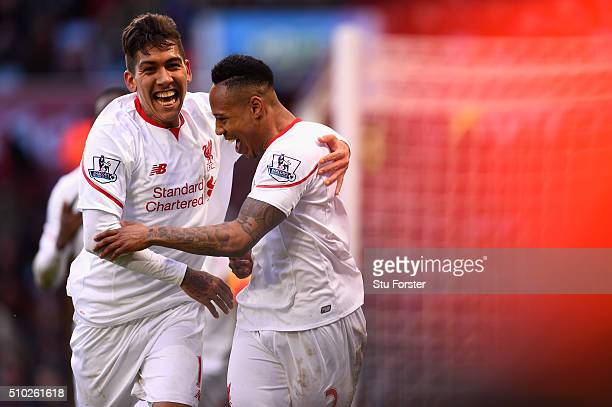 Nathaniel Clyne of Liverpool celebrates with teammate Roberto Firmino after scoring his team's fifth goal during the Barclays Premier League match...