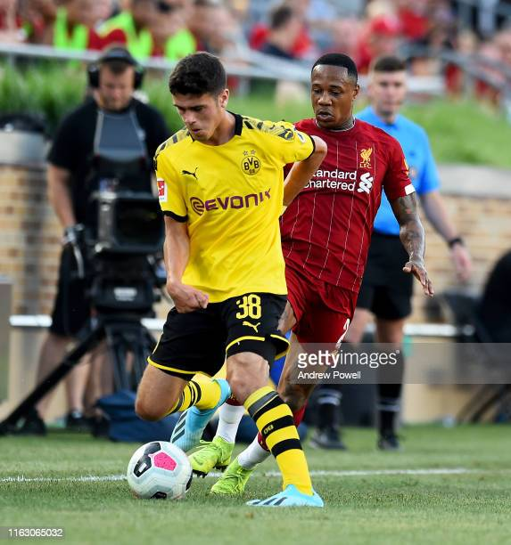 Nathaniel Clyne of Liverpool competes with Giovanni Reyna of Borussia Dortmund during the preseason friendly match between Borussia Dortmund and...