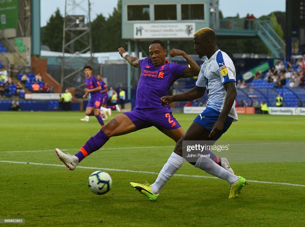 Nathaniel Clyne of Liverpool competes with Kai Tonga of Tranmere Rovers during the pre-season friendly match between Tranmere Rovers and Liverpool at Prenton Park on July 10, 2018 in Birkenhead, England.