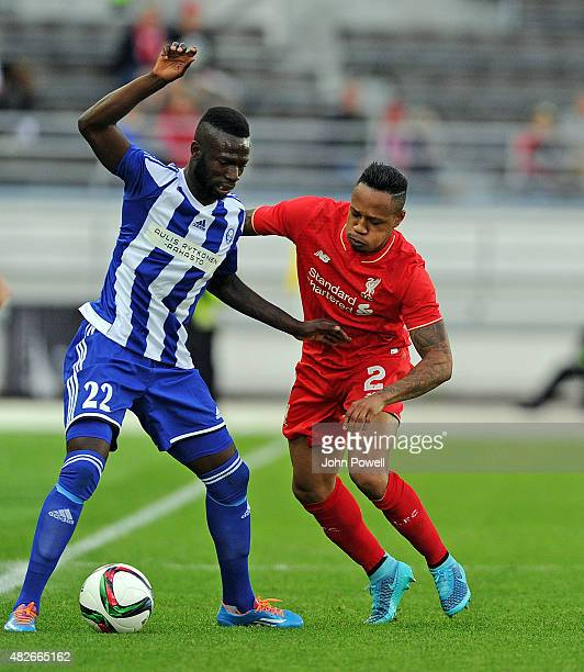 Nathaniel Clyne of Liverpool FC and Formose Mendy of HJK Helsinki in action during the pre season friendly match at Olympic Stadium on August 1, 2015...