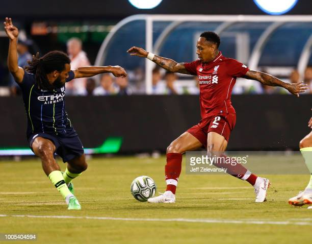 Nathaniel Clyne of Liverpool fights for the ball with Jason Denayer of Manchester City during their match at MetLife Stadium on July 25 2018 in East...