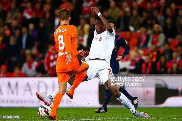 Nathaniel Clyne of Liverpool fights for the ball with Steven Lustica of the Brisbane Roar during the friendly football match between English Premier...