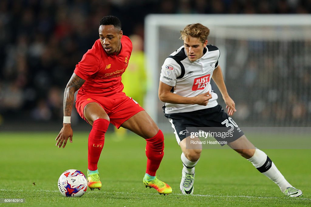 Nathaniel Clyne of Liverpool in action with Timi Elsnik of Derby County during the EFL Cup Third Round match between Derby County and Liverpool at iPro Stadium on September 20, 2016 in Derby, England.