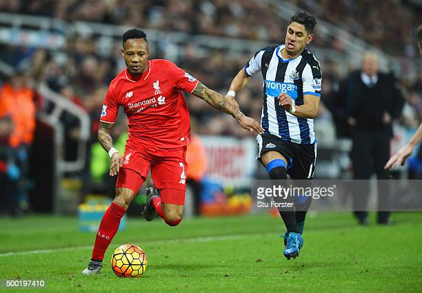 Nathaniel Clyne of Liverpool is chased by Ayoze Perez of Newcastle United during the Barclays Premier League match between Newcastle United and...