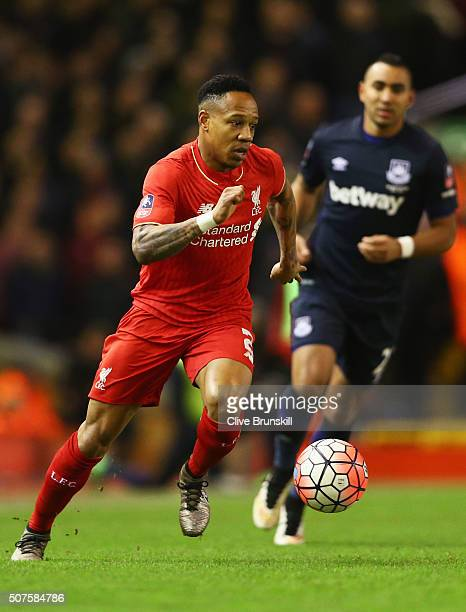 Nathaniel Clyne of Liverpool is chased by Dimitri Payet of West Ham United during the Emirates FA Cup Fourth Round match between Liverpool and West...