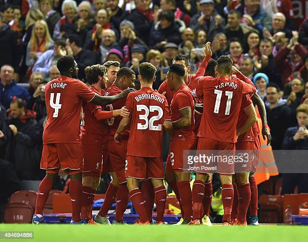 Nathaniel Clyne of Liverpool is congratulated after his goal during the Capital One Cup Fourth Round match between Liverpool and AFC Bournemouth at...