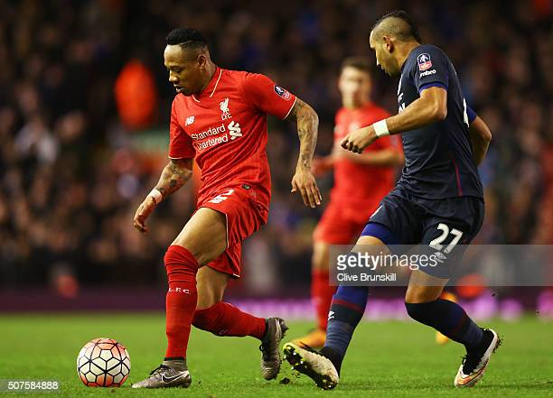 Nathaniel Clyne of Liverpool is watched by Dimitri Payet of West Ham United during the Emirates FA Cup Fourth Round match between Liverpool and West...