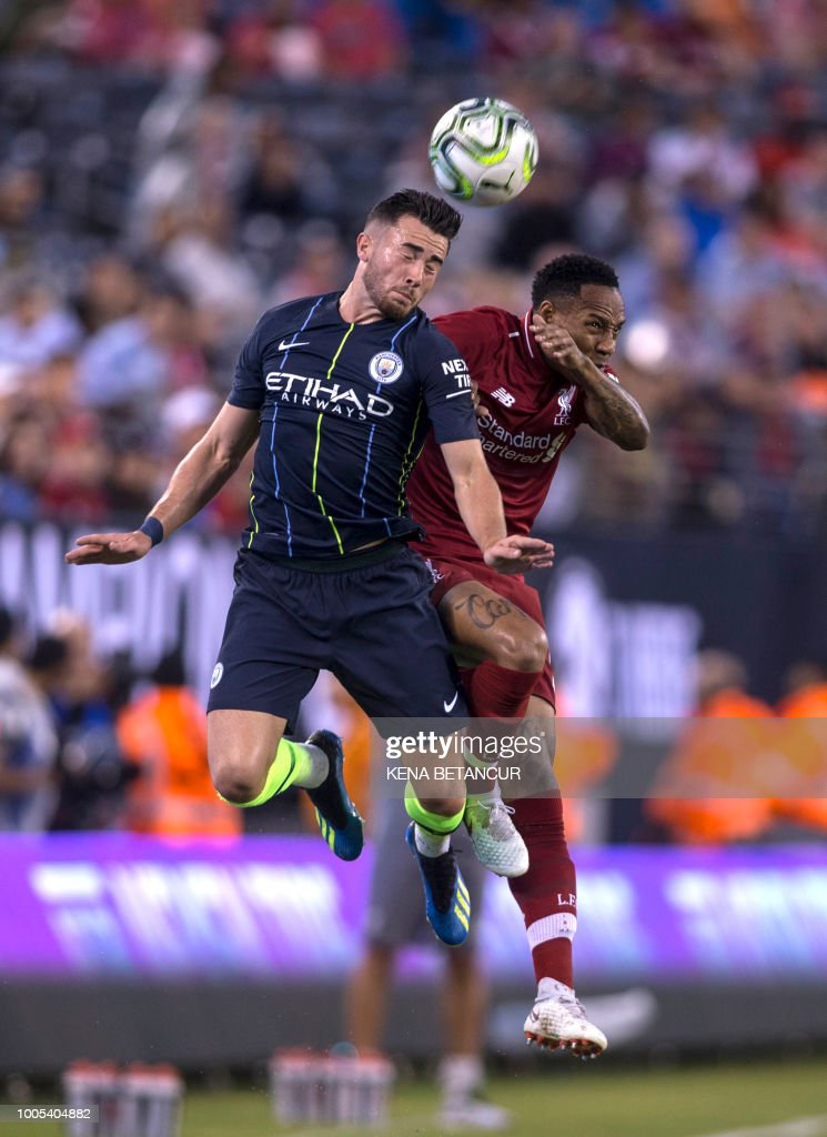 Nathaniel Clyne (R) of Liverpool jumps for a header with Jack Harrison (L) of Manchester City during the International Champions Cup at MetLife Stadium in East Rutherford, New Jersey on July 25, 2018.