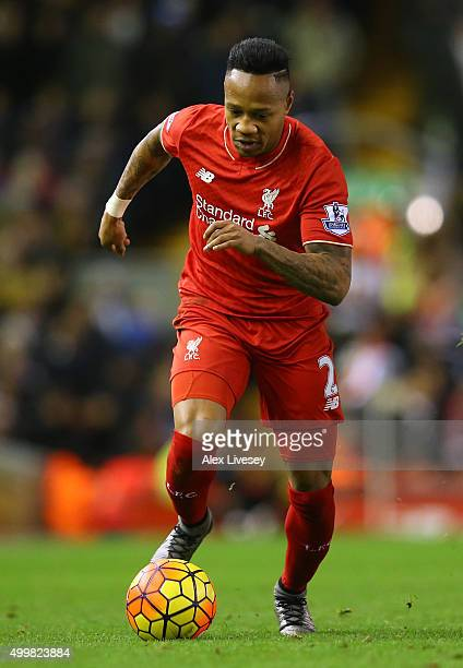 Nathaniel Clyne of Liverpool runs with the ball during the Barclays Premier League match between Liverpool and Swansea City at Anfield on November 29...