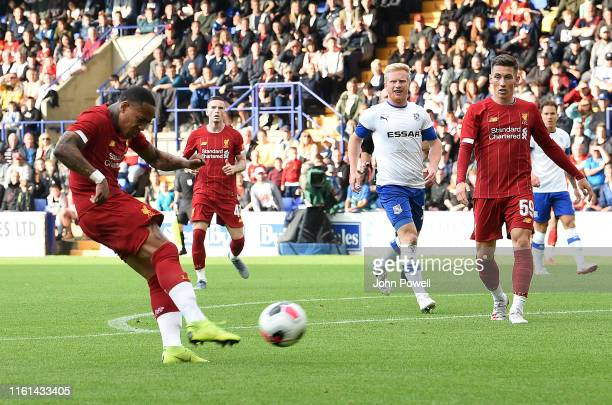 Nathaniel Clyne of Liverpool scores the opening goal during the PreSeason Friendly match between Tranmere and Liverpool at Prenton Park on July 11...