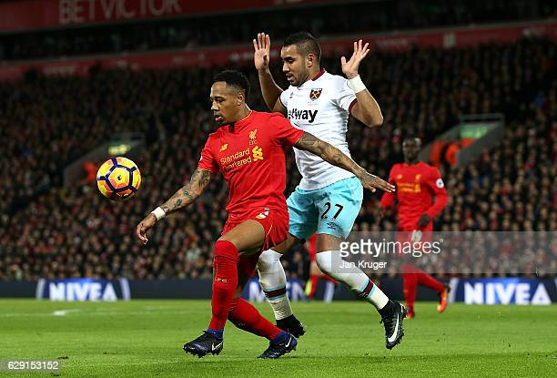 Nathaniel Clyne of Liverpool shields the ball from Dimitri Payet of West Ham during the Premier League match between Liverpool and West Ham United at...